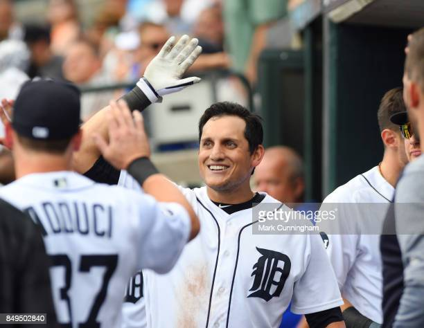 Mikie Mahtook of the Detroit Tigers gets highfives from teammates in the dugout during the game against the Pittsburgh Pirates at Comerica Park on...