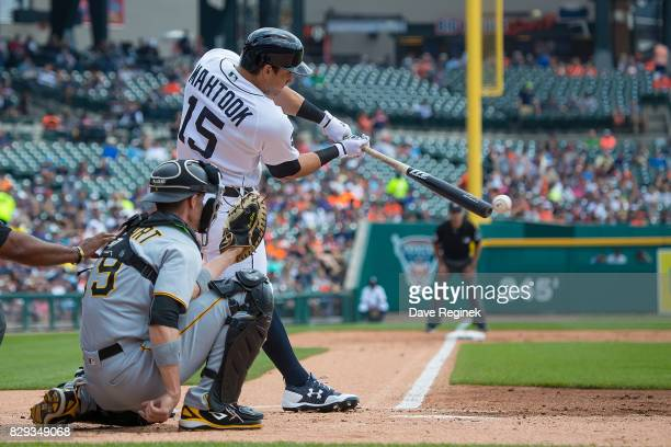 Mikie Mahtook of the Detroit Tigers hits a single in the first inning against the Pittsburgh Pirates during a MLB game at Comerica Park on August 10...