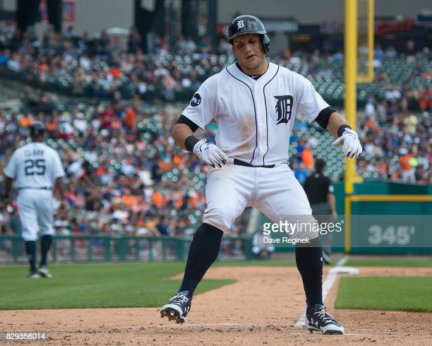 Mikie Mahtook of the Detroit Tigers hits a solo home run in the third inning against the Pittsburgh Pirates during a MLB game at Comerica Park on...