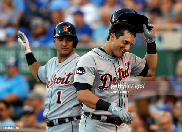 Mikie Mahtook of the Detroit Tigers is congratulated by Jose Iglesias after hitting a tworun home run during the 3rd inning of the game against the...