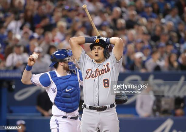 Mikie Mahtook of the Detroit Tigers reacts after being called out on strikes in the eighth inning on Opening Day during MLB game action against the...