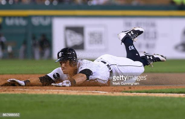 Mikie Mahtook of the Detroit Tigers slides head first into third base during the game against the Chicago White Sox at Comerica Park on September 16...