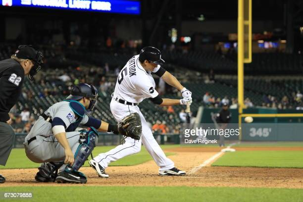 Mikie Mahtook of the Detroit Tigers swings and makes contact during a MLB game against the Seattle Mariners at Comerica Park on April 25 2017 in...