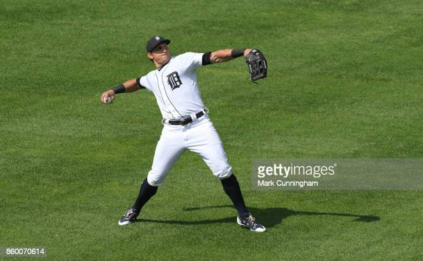 Mikie Mahtook of the Detroit Tigers throws a baseball during the game against the Oakland Athletics at Comerica Park on September 20 2017 in Detroit...