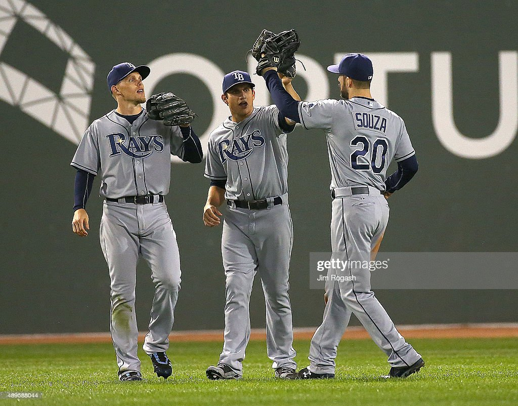 Mikie Mahtook #27 of the Tampa Bay Rays celebrates a 5-3 win over the Boston Red Sox with teammates Steven Souza Jr. and Brandon Guyer #5 at Fenway Park on September 22, 2015 in Boston, Massachusetts.