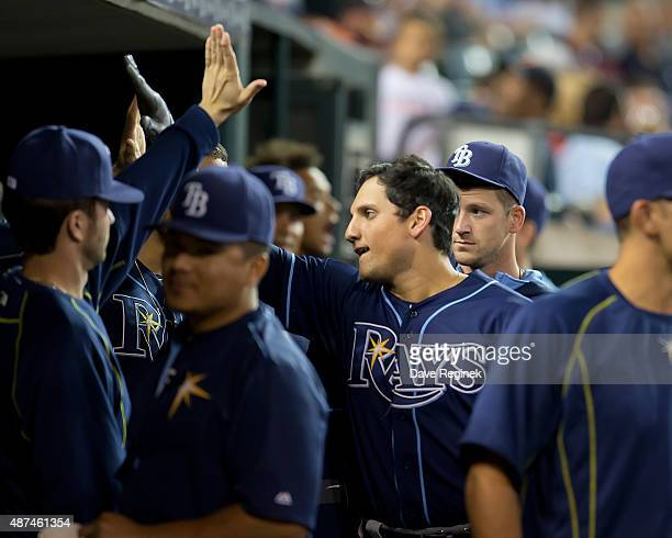 Mikie Mahtook of the Tampa Bay Rays celebrates hitting a home run in the seventh inning in the dugout during a MLB game against the Detroit Tigers at...