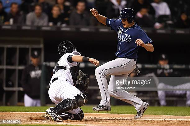 Mikie Mahtook of the Tampa Bay Rays is tagged out at home by Omar Narvaez of the Chicago White Sox during the eighth inning of a game at US Cellular...