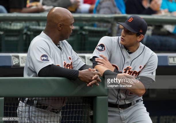 Mikie Mahtook right of the Detroit Tigers talks with third base coach Dave Clark before a game against the Seattle Mariners at Safeco Field on June...