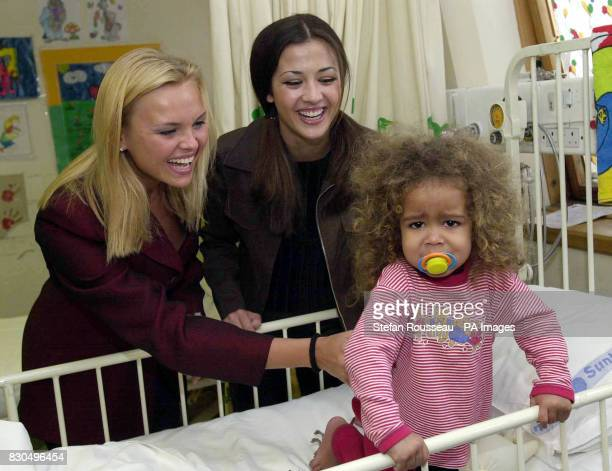 Mikie Turner from Dulwich tries to escape the attentions of Miss World contestants who were presenting a cake to The Variety Club Childrens Hospital...