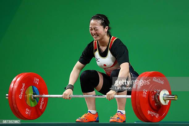 Mikiko Andoh of Japan competes during the Women's 58kg Group A weightlifting contest on Day 3 of the Rio 2016 Olympic Games at the Riocentro Pavilion...