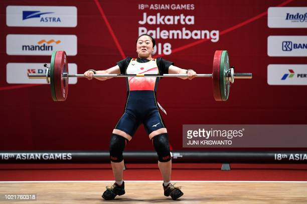 Mikiko Andoh of Japan competes in the women's 58kg weightlifting event during the 2018 Asian Games in Jakarta on August 23 2018 / The erroneous...