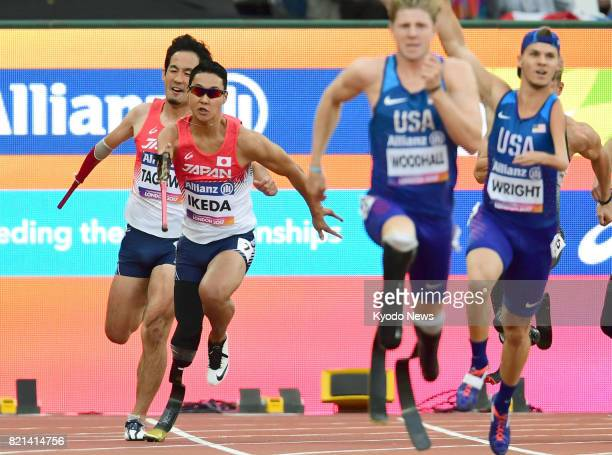 Mikio Ikeda runs the anchor leg for Japan after being tagged by Tomoki Tagawa during the men's 4x100meter relay T4247 final at the World Para...