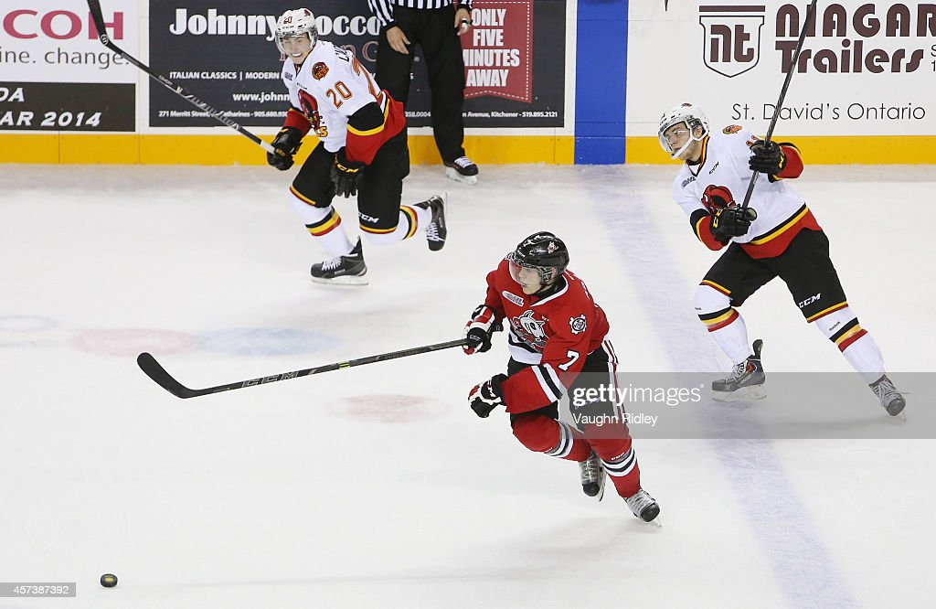 Mikkel Aagaard #7 of the Niagara Ice Dogs heads up the ice with Cole Candella #20 of the Belleville Bulls during an OHL game against the at the Meridian Centre on October 16, 2014 in St Catharines, Ontario, Canada.