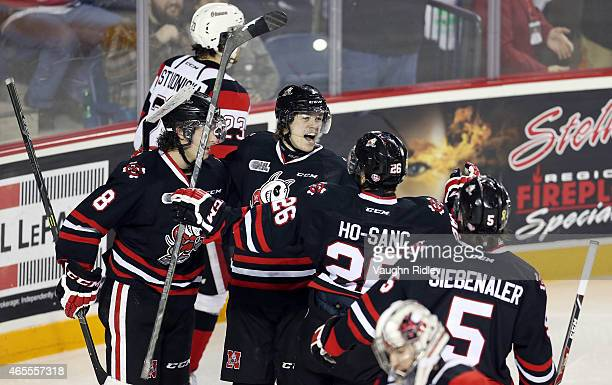 Mikkel Aagaard of the Niagara IceDogs celebrates his 3rd goal with Billy Jenkins Josh HoSang and Blake Siebenaler during an OHL game against the...