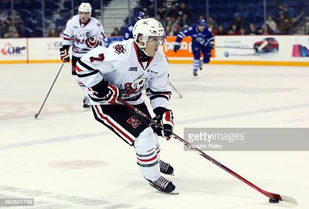 Mikkel Aagaard of the Niagara IceDogs skates with the puck during an OHL game against the Mississauga Steelheads at the Meridian Centre on October 29...