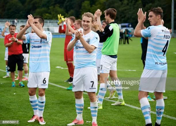 Mikkel Basse of FC Helsingor Anders Holst of FC Helsingor and Martin Fisch of FC Helsingor celebrate after the Danish Alka Superliga match between FC...