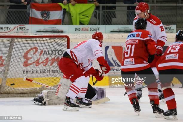 Mikkel Bodker of Denmark, Dominique Heinrich of Austria, and Morten Madsen of Denmark during the Austria v Denmark - Ice Hockey International...