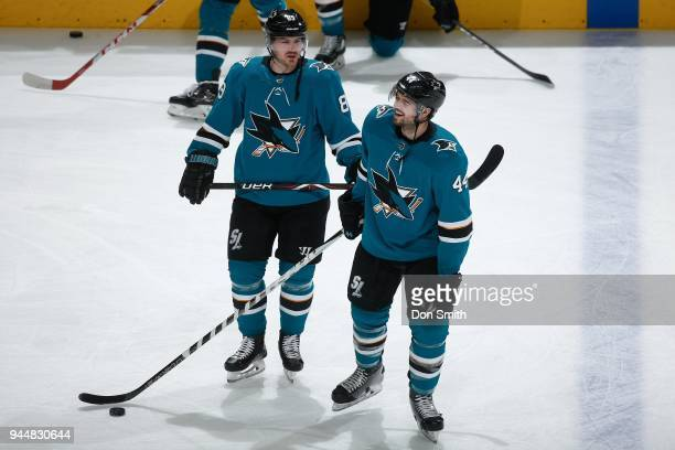 Mikkel Boedker and MarcEdouard Vlasic of the San Jose Sharks share a laugh during warmups before playing the Minnesota Wild at SAP Center on April 7...