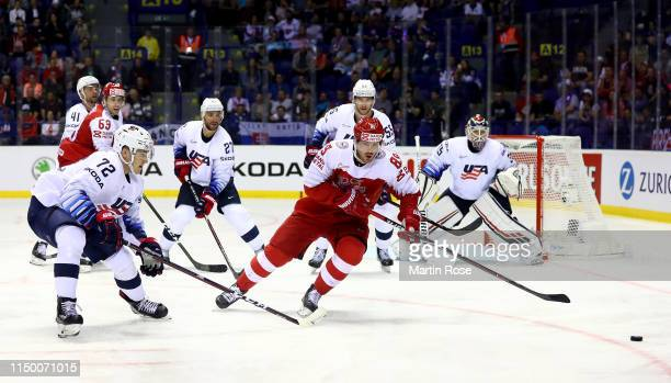 Mikkel Boedker of Denmark challenges Frank Vatrano of United States during the 2019 IIHF Ice Hockey World Championship Slovakia group A game between...