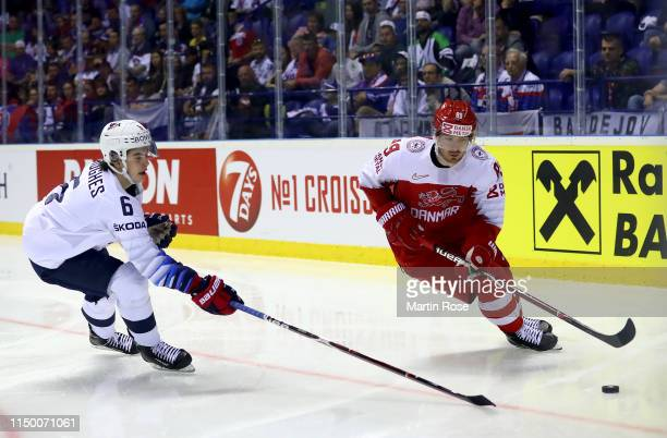 Mikkel Boedker of Denmark challenges Jack Hughes of United States during the 2019 IIHF Ice Hockey World Championship Slovakia group A game between...
