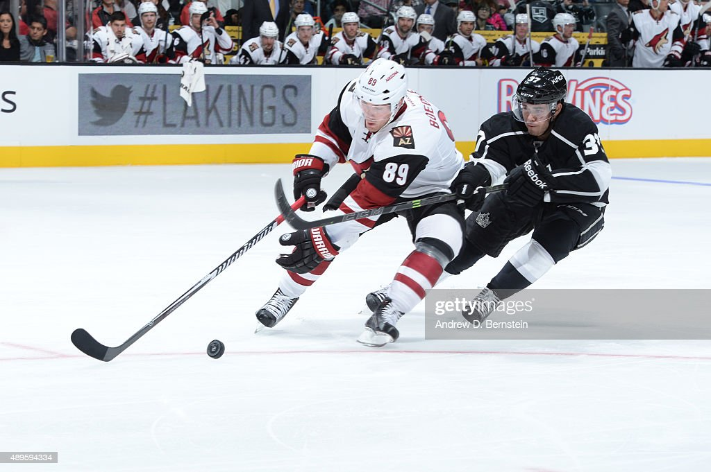 Mikkel Boedker #89 of the Arizona Coyotes and Nick Shore #37 of the Los Angeles Kings fight for possession of the puck during a game at STAPLES Center on September 22, 2015 in Los Angeles, California.