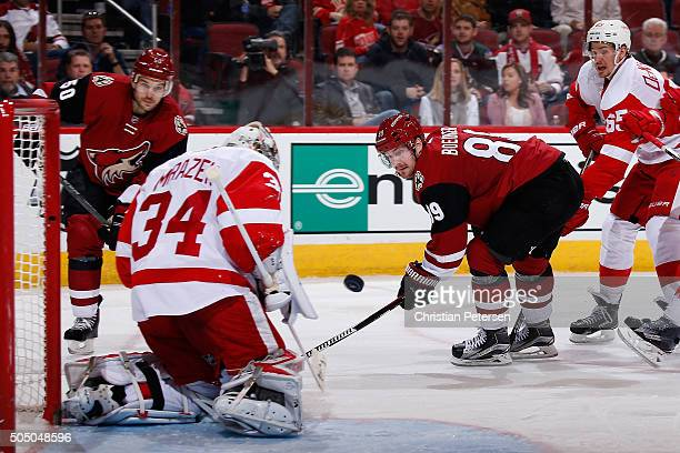 Mikkel Boedker of the Arizona Coyotes shoots the puck on goaltender Petr Mrazek of the Detroit Red Wings during the third period of the NHL game at...