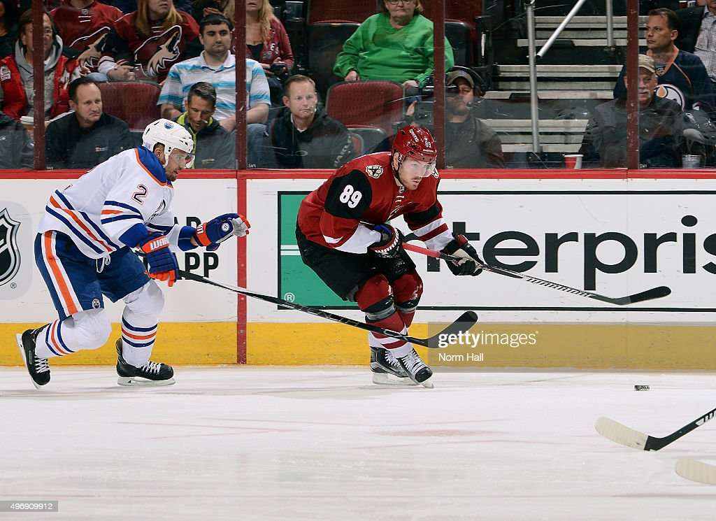 Mikkel Boedker #89 of the Arizona Coyotes skates with the puck ahead of Andrej Sekera #2 of the Edmonton Oilers during the third period at Gila River Arena on November 12, 2015 in Glendale, Arizona.