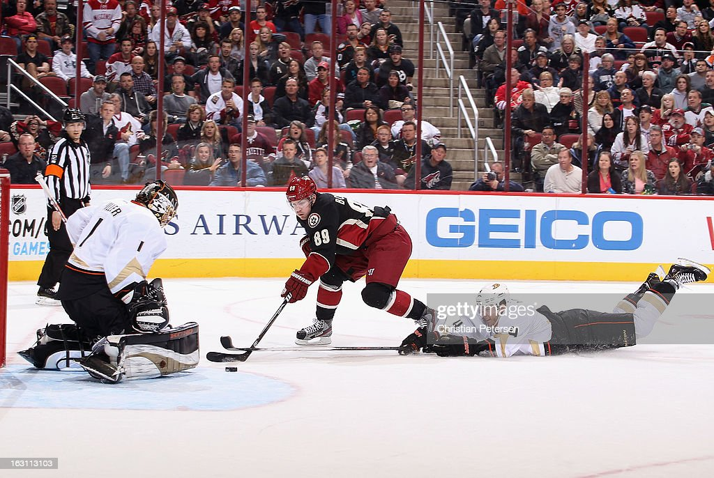 Mikkel Boedker #89 of the Phoenix Coyotes attempts to score a goal against goaltender Jonas Hiller #1 and past the diving Cam Fowler #4 of the Anaheim Ducks during the overtime of the NHL game at Jobing.com Arena on March 4, 2013 in Glendale, Arizona. The Coyotes defeated the Ducks 5-4 in an overtime shootout.