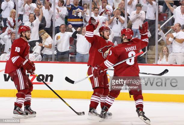 Mikkel Boedker of the Phoenix Coyotes celebrates with Keith Yandle and Shane Doan after scoring a second period goal against the Nashville Predators...