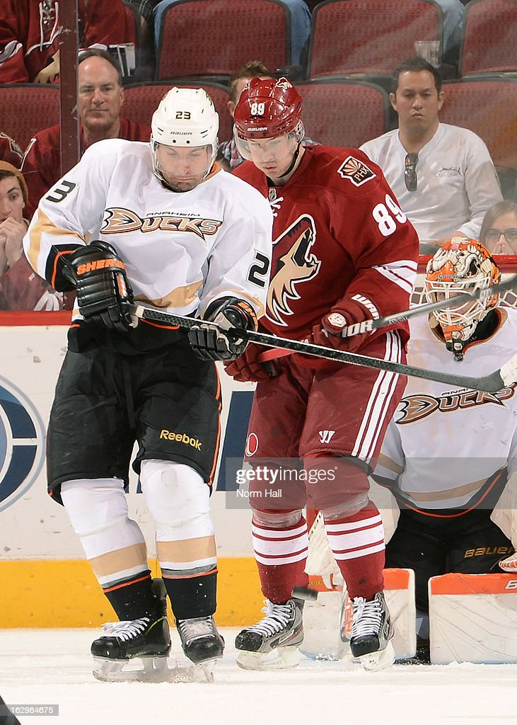 Mikkel Boedker #89 of the Phoenix Coyotes looks to deflect a shot while being defended by Francois Beauchemin #23 of the Anaheim Ducks at Jobing.com Arena on March 2, 2013 in Glendale, Arizona.
