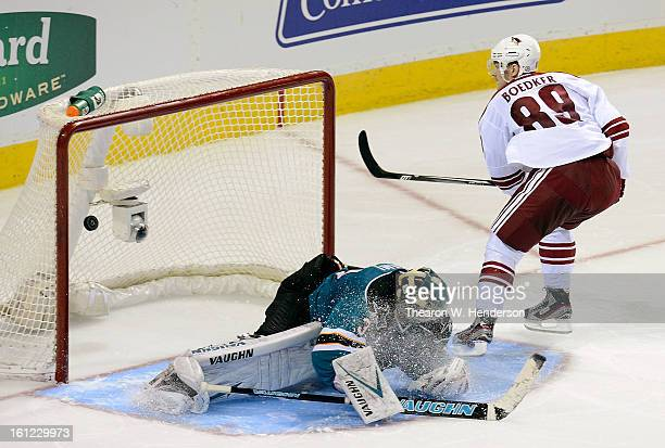 Mikkel Boedker of the Phoenix Coyotes scores getting his shot past goalkeeper Antti Niemi of the San Jose Sharks during an overtime shootout at HP...