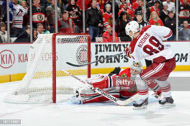 Mikkel Boedker of the Phoenix Coyotes scores on his shootout attempt against goalie Corey Crawford of the Chicago Blackhawks during the NHL game on...