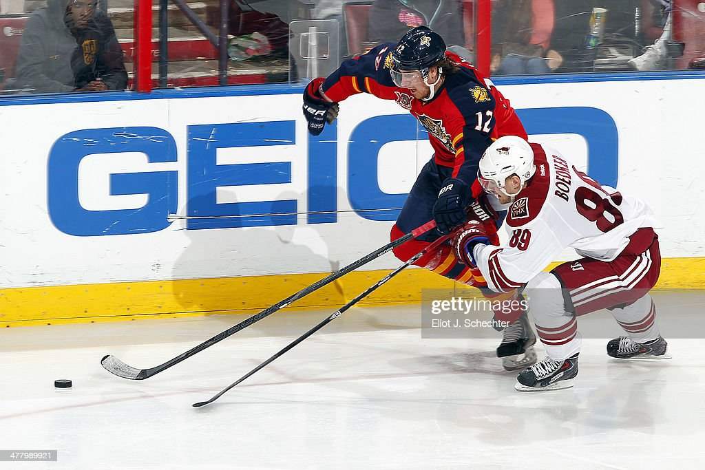 Mikkel Boedker #89 of the Phoenix Coyotes tangles with Jimmy Hayes #12 of the Florida Panthers at the BB&T Center on March 11, 2014 in Sunrise, Florida.