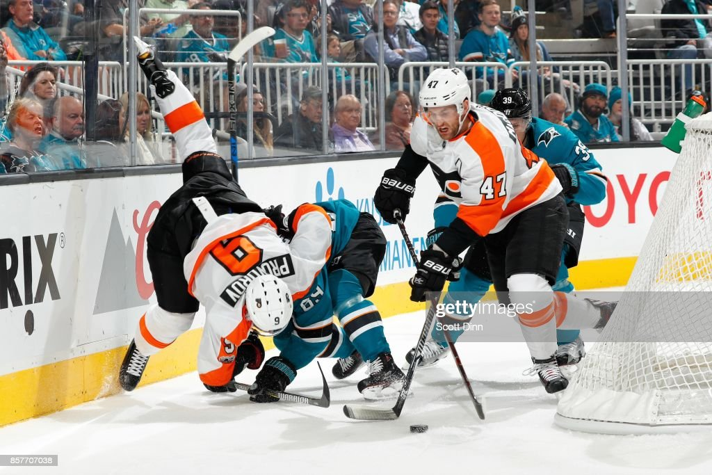 Mikkel Boedker #89 of the San Jose Sharks along with Ivan Provorov #9 and Andrew MacDonald #47 of the Philadelphia Flyers battle along the boards behind the net during a NHL game at SAP Center at San Jose on October 4, 2017 in San Jose, California.