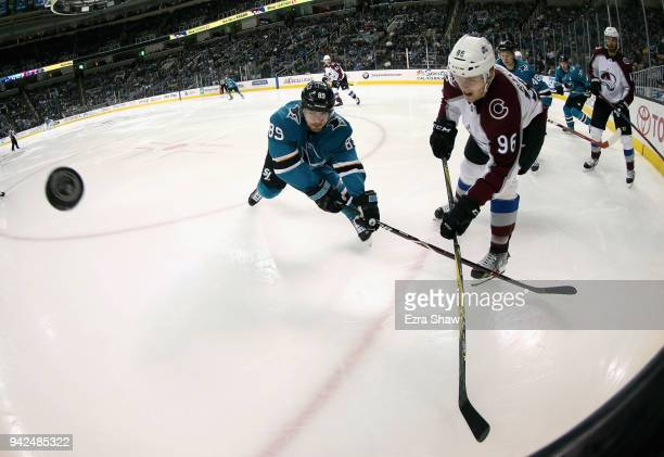 Mikkel Boedker of the San Jose Sharks and Mikko Rantanen of the Colorado Avalanche go for the puck at SAP Center on April 5 2018 in San Jose...
