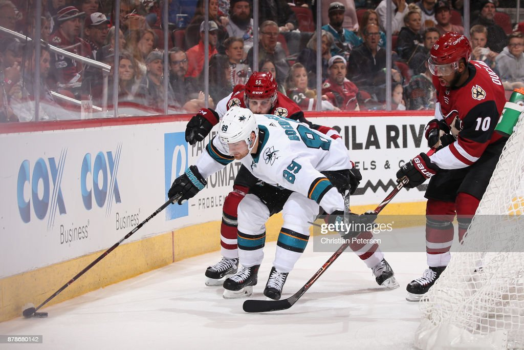 Mikkel Boedker #89 of the San Jose Sharks attempts to control the puck during the third period of the NHL game against the Arizona Coyotes at Gila River Arena on November 22, 2017 in Glendale, Arizona. The Sharks defeated the Coyotes 3-1.