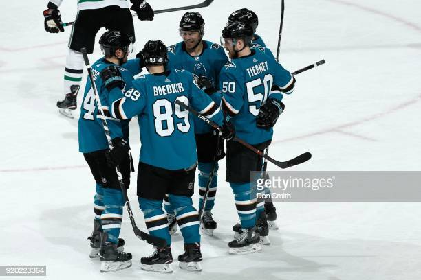 Mikkel Boedker of the San Jose Sharks celebrates his second goal in the first period against the Dallas Stars with teammates at SAP Center on...