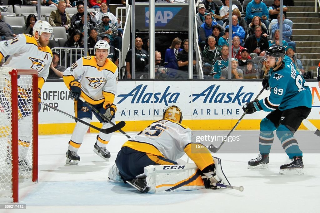 Mikkel Boedker #89 of the San Jose Sharks gets the puck by Pekka Rinne #35 of the Nashville Predators to score in the third period at SAP Center on November 1, 2017 in San Jose, California.