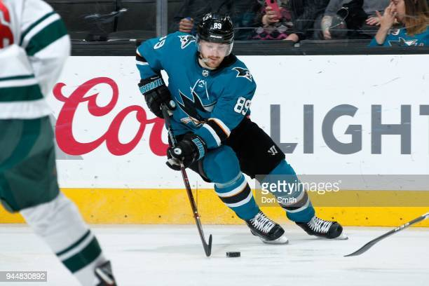 Mikkel Boedker of the San Jose Sharks moves the puck during a NHL game against the Minnesota Wild at SAP Center on April 7 2018 in San Jose...