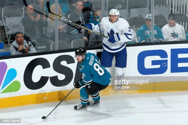 Mikkel Boedker of the San Jose Sharks skates against Alexey Marchenko of the Toronto Maple Leafs during a NHL game at SAP Center at San Jose on...