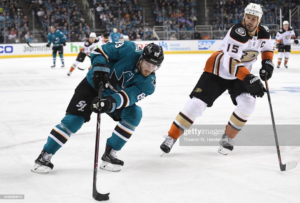 Mikkel Boedker of the San Jose Sharks skates up ice with control of ... 4e05bb4c3