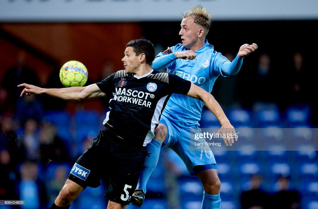 Mikkel Cramer of Silkeborg IF and Marcus Molvadgaard of Randers FC compete for the ball during the Danish Alka Superliga match between Randers FC and Silkeborg IF at BioNutria Park on August 18, 2017 in Randers, Denmark.