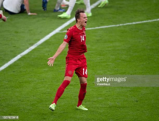 Mikkel Damsgaard of Denmark celebraqtes scoring a free kick during the UEFA Euro 2020 Championship Semi-final match between England and Denmark at...