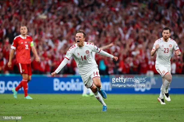 Mikkel Damsgaard of Denmark celebrates after scoring their side's first goal during the UEFA Euro 2020 Championship Group B match between Russia and...