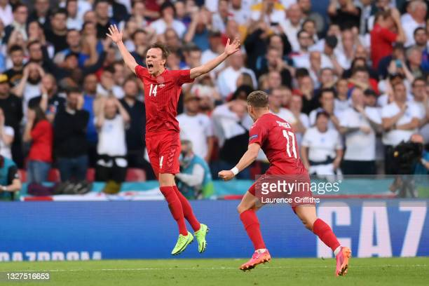 Mikkel Damsgaard of Denmark celebrates after scoring their side's first goal during the UEFA Euro 2020 Championship Semi-final match between England...