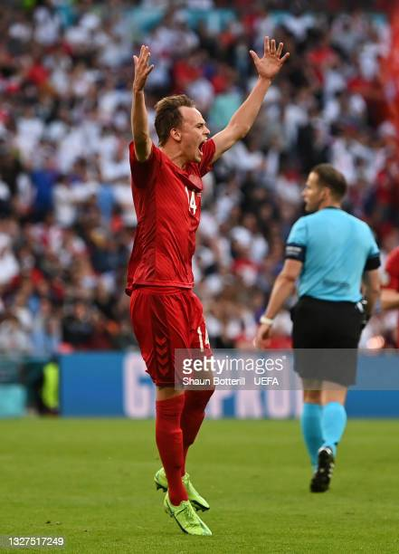 Mikkel Damsgaard of Denmark celebrates after scoring their team's first goal during the UEFA Euro 2020 Championship Semi-final match between England...