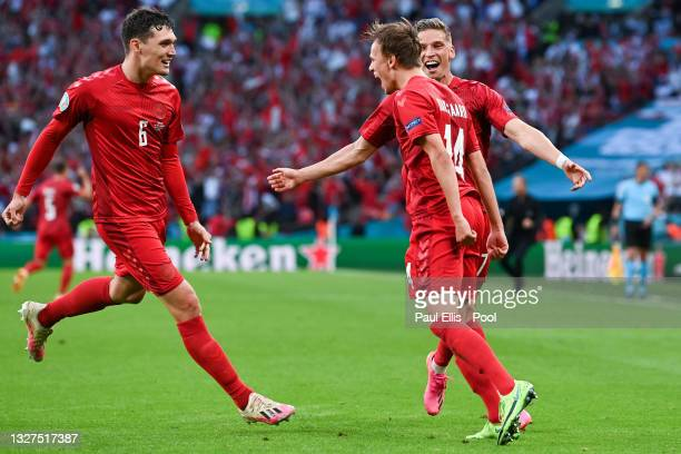 Mikkel Damsgaard of Denmark celebrates with Andreas Christensen and Jens Stryger Larsen after scoring their side's first goal during the UEFA Euro...