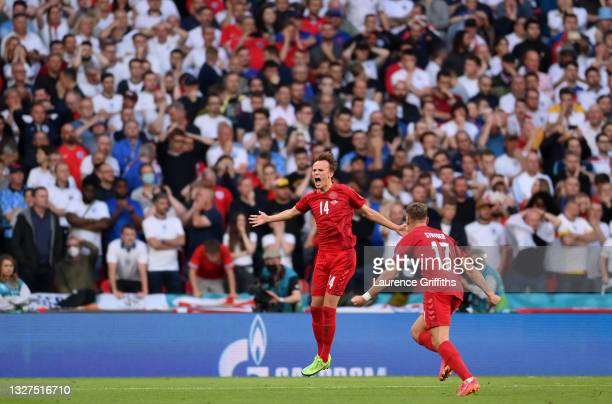 Mikkel Damsgaard of Denmark celebrates with Jens Stryger Larsen after scoring their side's first goal during the UEFA Euro 2020 Championship...