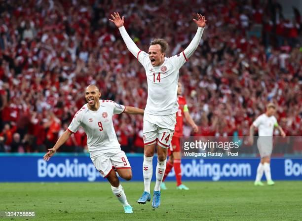 Mikkel Damsgaard of Denmark celebrates with teammate Martin Braithwaite after scoring their side's first goal during the UEFA Euro 2020 Championship...