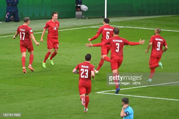Mikkel Damsgaard of Denmark celebrates with teammates after scoring their side's first goal during the UEFA Euro 2020 Championship Semi-final match...